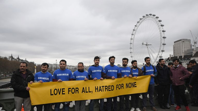 People hold a banner on Westminster Bridge