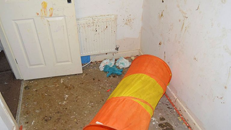 The walls of the house were smeared with excrement