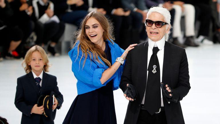 German designer Karl Lagerfeld and model Cara Delevingne