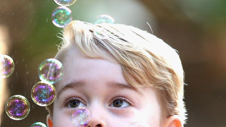 Prince George plays with bubbles at a children's party for Military families at Government House in Victoria during the Royal Tour of Canada in September 2016