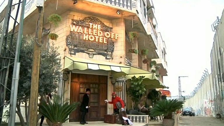 Banksy's latest creation, a hotel, stands just metres from the Israeli separation wall in Bethlehem. Pic: Reuters