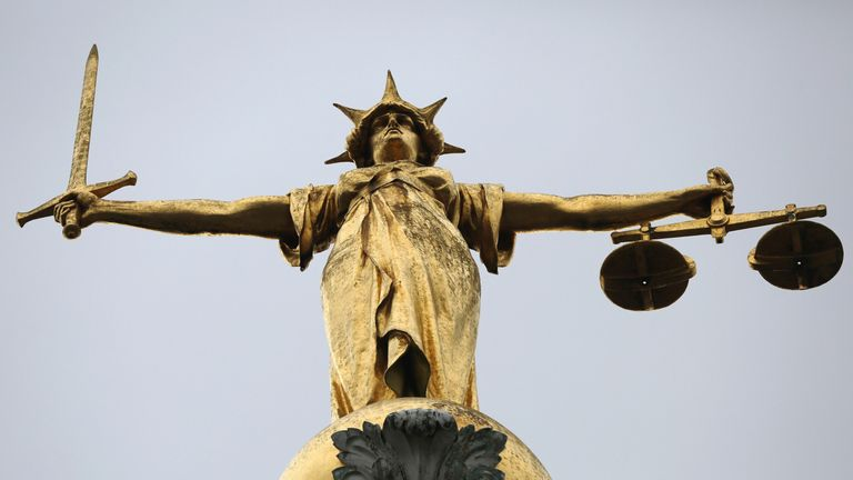 A statue of the scales of justice above the Old Bailey