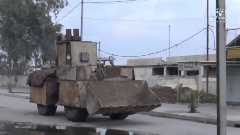 IS have used an armoured digger to smuggle a suicide bomb to the frontline in Mosul