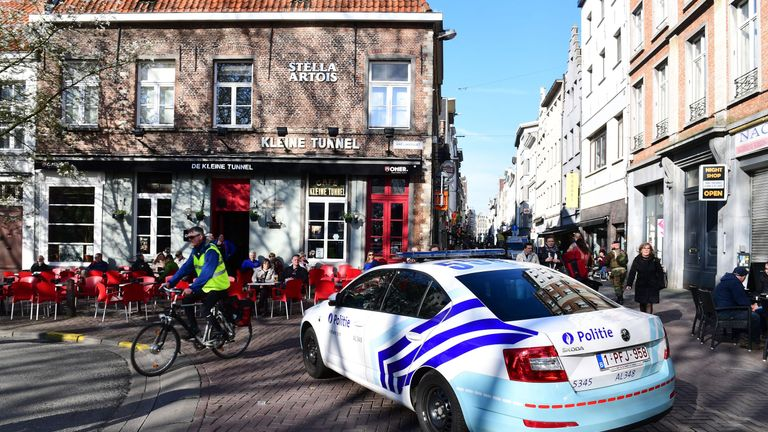 A police car blocks access to the Meir, Antwerp's main pedestrian street, after a man was arrested after he tried to drive into a crowd of shoppers at high speed on the street, on March 23, 2017, in Antwerp