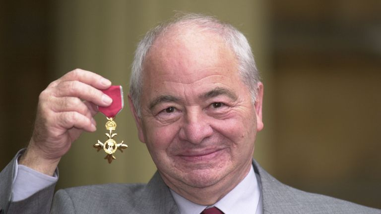 Colin Dexter with his OBE in 2000