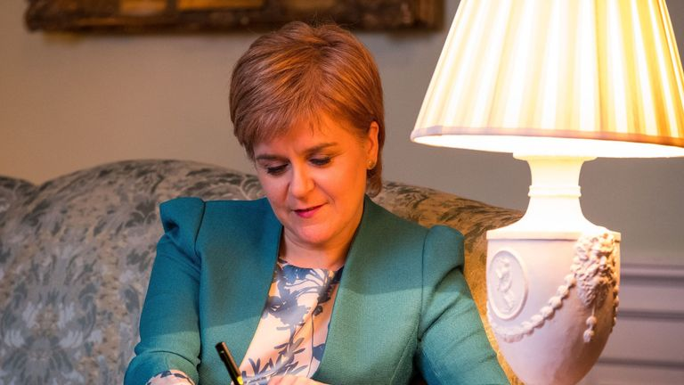 The First Minister working on the letter