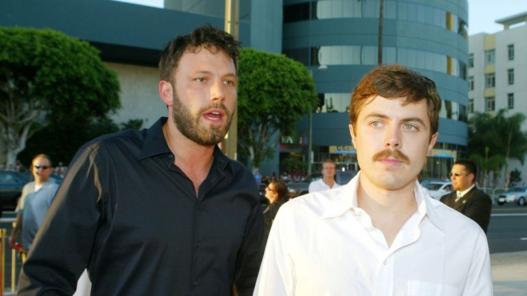 Ben Affleck (L) and Casey Affleck arrive at the premiere of Universal's 'The Bourne Supremacy