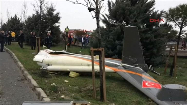 The tail of the helicopter at the crash scene