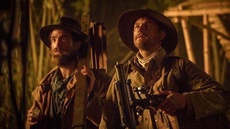 Robert Pattinson stars alongside Hunnam in the film