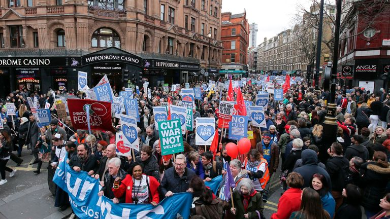 Protesters march with banners and placards against private companies' involvement in the National Health Service (NHS) and social care services provision and against cuts to NHS funding in central London on March 4, 2017. People gathered to demonstrate at the rally publicised by the People's Assembly Against Austerity to demand a fully and publicly funded NHS and social care service, returned fully to public ownership and provision and to say no to cuts in NHS funding