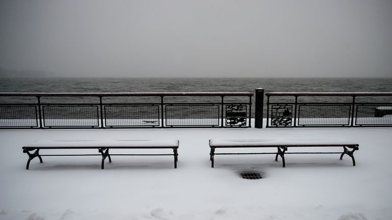 Benches covered in snow in Battery Park, New York City