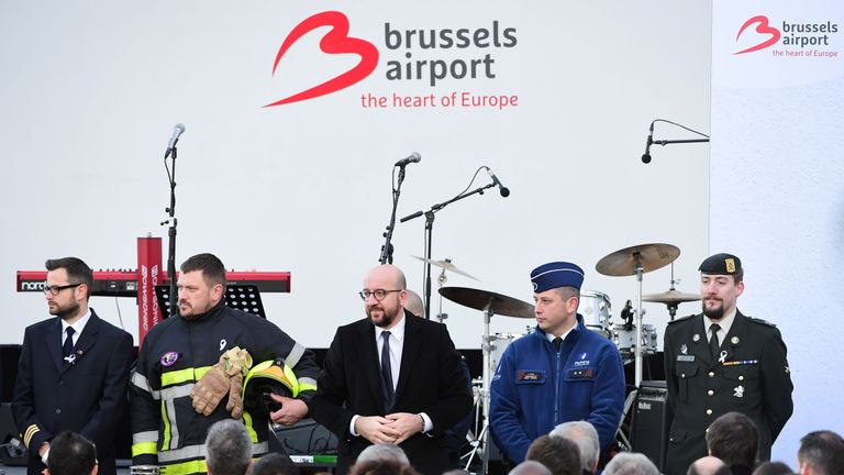 Belgium's Prime Minister Charles Michel stands with members of the security and rescue service
