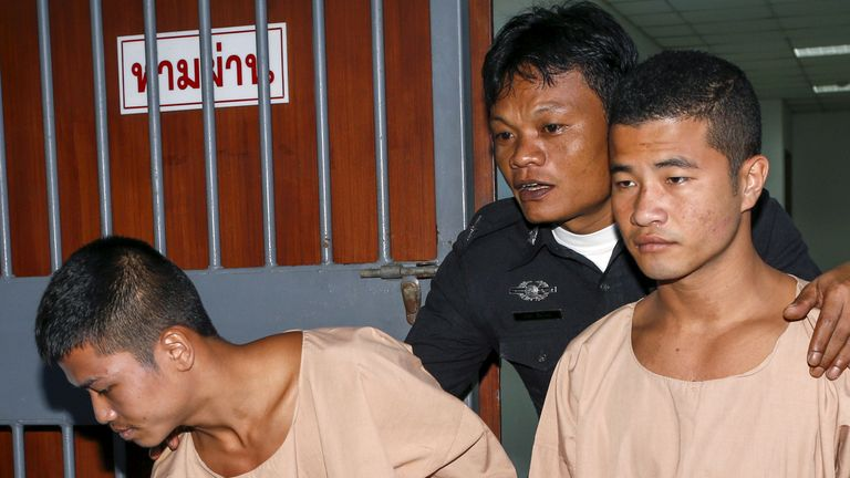 Zaw Lin (L) and Win Zaw Htun (R) leave court after being sentenced to death in December 2015