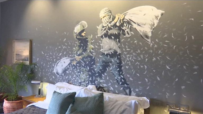 The hotel's 'Banksy Room' features a mural of an Israeli and Palestinian having a pillow fight