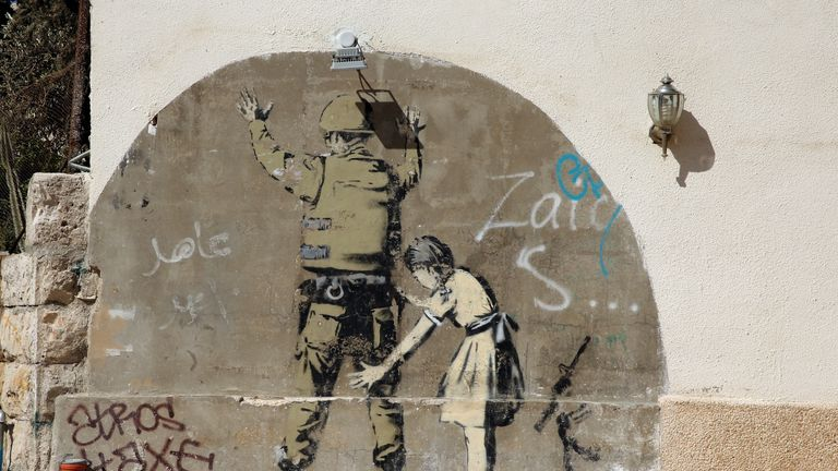 A Banksy wall painting, on the Israeli West Bank barrier near Bethlehem
