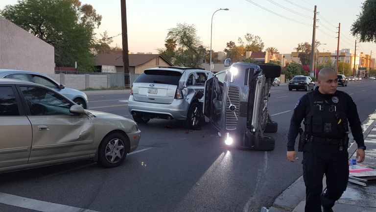 A self-driven Volvo SUV owned and operated by Uber Technologies Inc. is flipped on its side after a collision in Tempe, Arizona