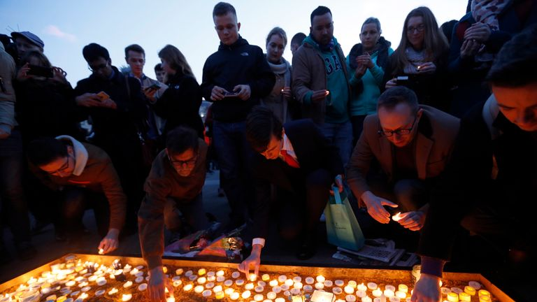 People light candles in Trafalgar Square for victims of the London attack