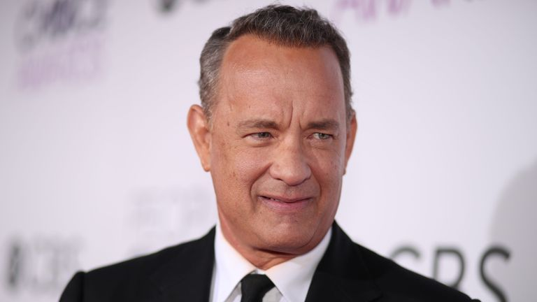 Hanks also left reporters a note of encouragement as they work in a hostile White House