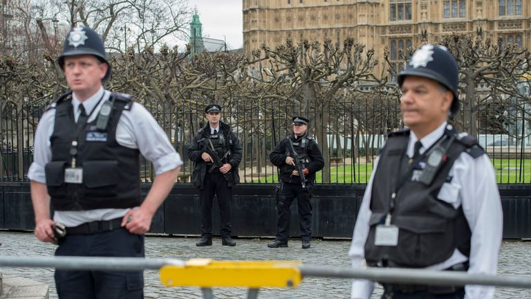 Armed police outside the gates of the Houses of Parliament