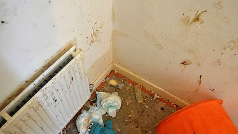 A screaming girl was trapped under a bed frame in a room full of faeces and flies