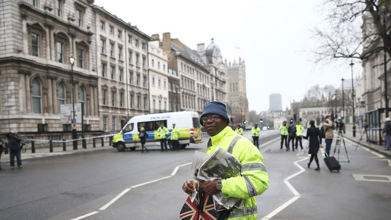 A man walks down Whitehall the morning after the attack