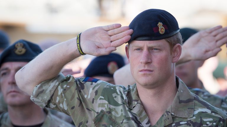 Prince Harry joins British troops and service personal remaining in Afghanistan and also International Security Assistance Force (ISAF) personnel and civilians as they gather for a Remembrance Sunday service at Kandahar Airfield November 9, 2014 in Kandahar, Afghanistan