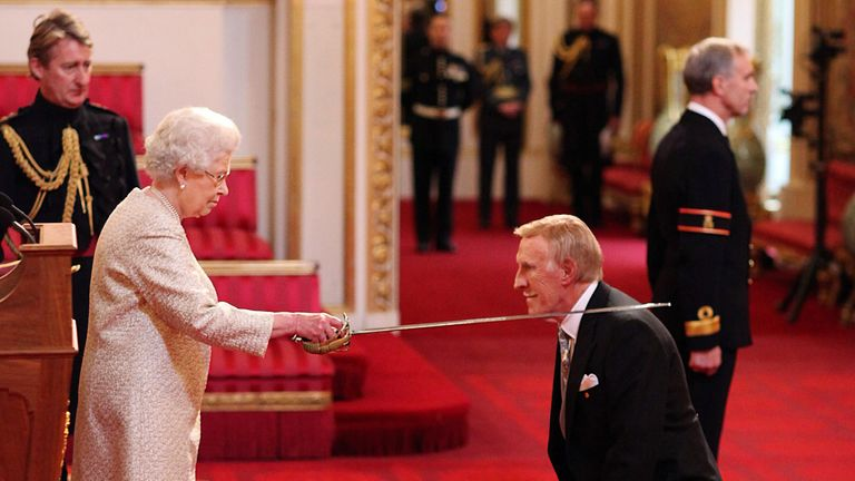 Veteran entertainer Sir Bruce Forsyth is knighted by Queen Elizabeth II at Buckingham Palace, London, 2011