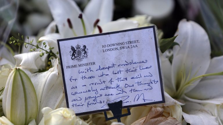 A floral tribute to the victims of the March 22 terror attack with a note from the office of the Prime Minister is pictured in Parliament Square in central London on March 26, 2017. The British government said on March 26 that its security services must have access to encrypted messaging applications such as WhatsApp, revealing it was used by the killer behind the parliament attack. / AFP PHOTO / DANIEL LEAL-OLIVAS (Photo credit should read DANIEL LEAL-OLIVAS/AFP/Getty Images)
