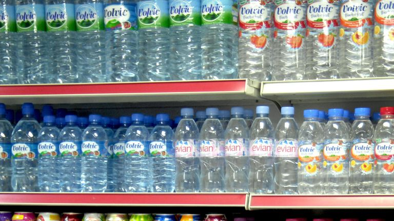 Bottles of soft drinks on a shop shelf. File pic