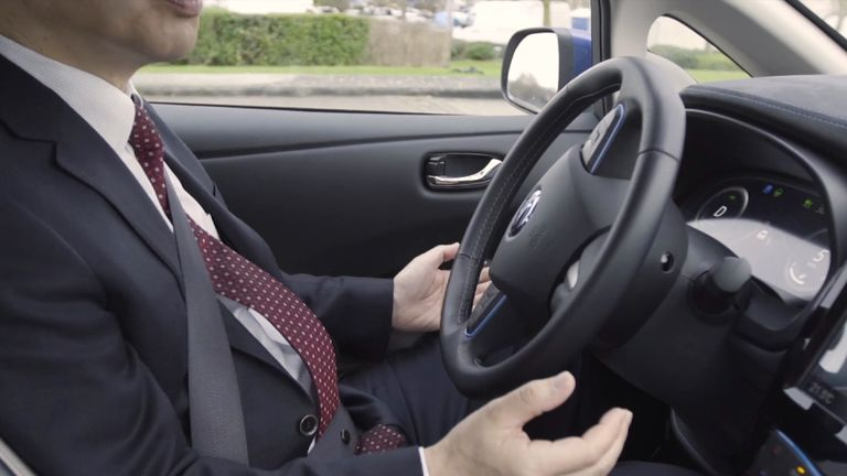 Look - no hands! A driverless car steers itself in London