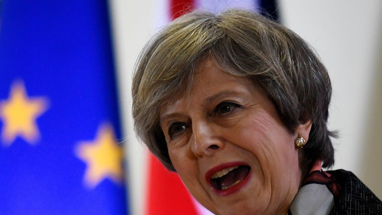 Prime Minister Theresa May attends a news conference during an EU summit