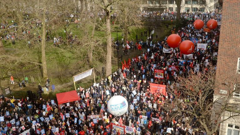 Demonstrators attend a rally in central London, in support of the NHS