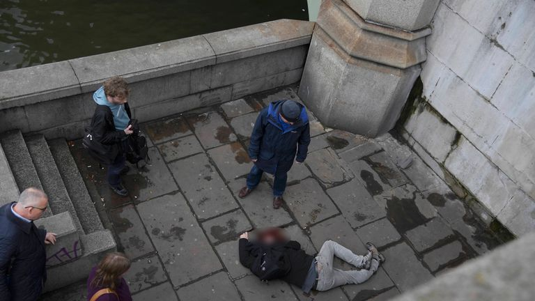 A man lies injured on Westminster Bridge