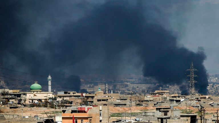Plumes of smoke rise from a neighbourhood in west Mosul