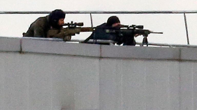 Snipers take position on a rooftop of the Dammartin-en-Goele complex where the Kouachi brothers are holed up