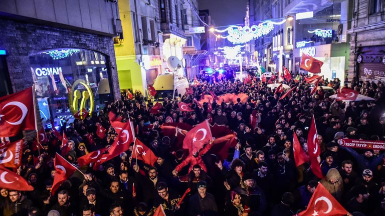 Protestors wave Turkish national flags as they shout slogans during a demonstration late on March 11, 2017 in front of the consulate of the Netherlands in Istanbul. The Dutch embassy in Ankara and consulate in Istanbul have been sealed off for 'security reasons', Turkish foreign ministry sources said on March 11, as tensions soar between Turkey and the Netherlands after a Dutch ban on the Turkish foreign minister's visit