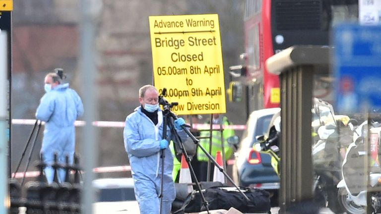 Police forensic officers on Westminster Bridge, close to the Palace of Westminster, London, after the terror attack