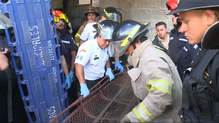 Firefighters preparing to enter the building