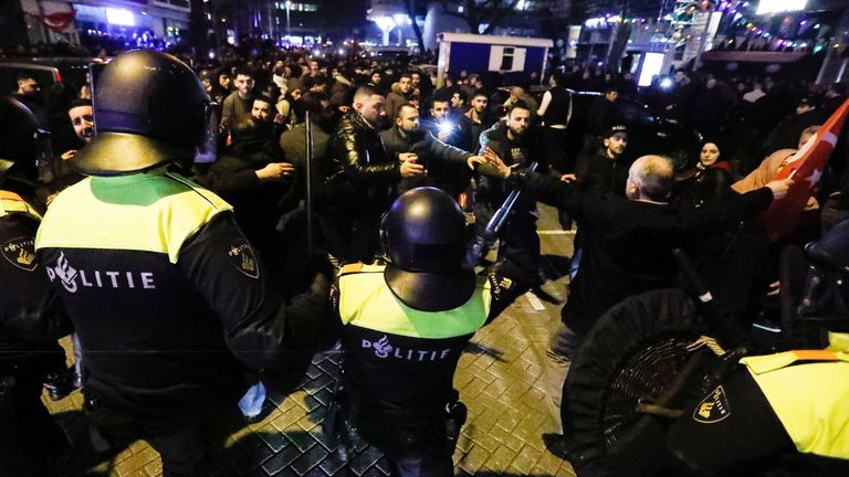 Demonstrators face Dutch riot police outside the Turkish consulate in Rotterdam, Netherlands March 12, 2017. REUTERS/Yves Herman