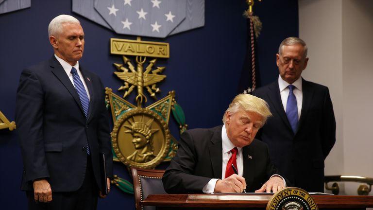 Donald Trump signs a new executive order invoking a travel ban