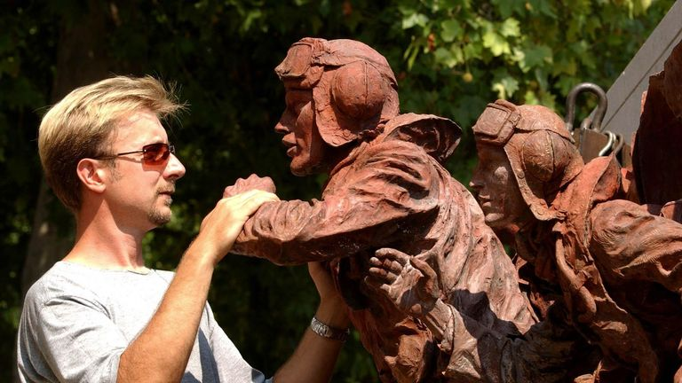 Sculptor Paul Day inspects his work on the Battle of Britain monument being built in 2005, from the Morris Singer Foundry in Hampshire