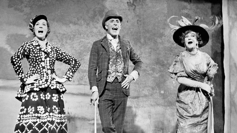 Julie Andrews, Bruce Forsyth and Beryl Reid sing 'Piccadilly,' a music hall ditty on stage at the old Brixton Music Hall, 1967