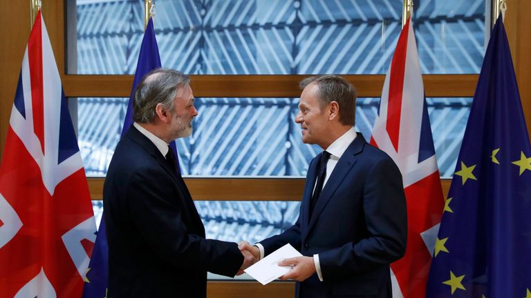 Tim Barrow delivers Theresa May's Brexit letter to EU Council President Donald Tusk in Brussels
