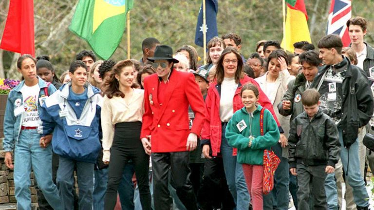 Jackson with wife Lisa Marie Presley, walking with children at his Neverland Ranch
