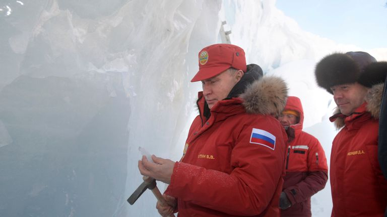 Vladimir Putin and Dmitry Medvedev visit the cave of Arctic Pilots Glacier