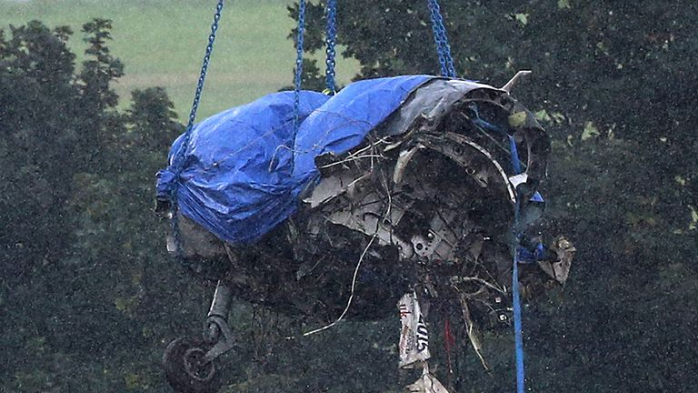 The remains of the  Hawker Hunter fighter jet are lifted by crane