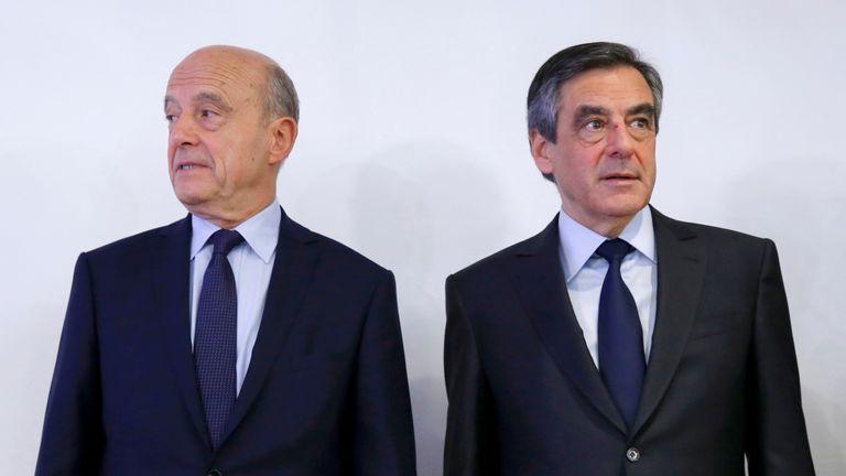 Alain Juppe (L) and Francois Fillon