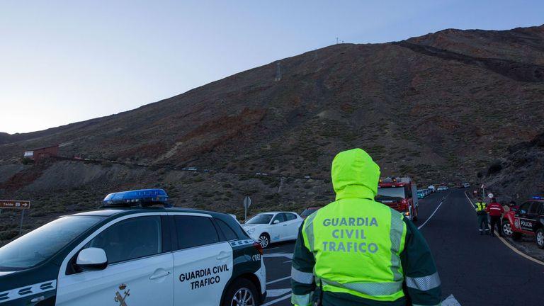 A Spanish gurdia Civil stands at the scene