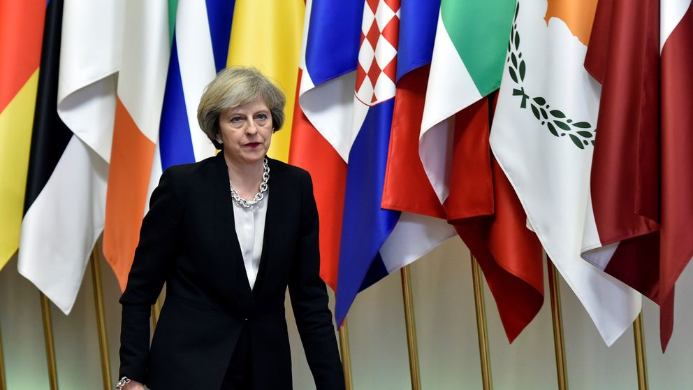 Theresa May leaves a EU Summit at the European Council headquarters in Brussels in 2016