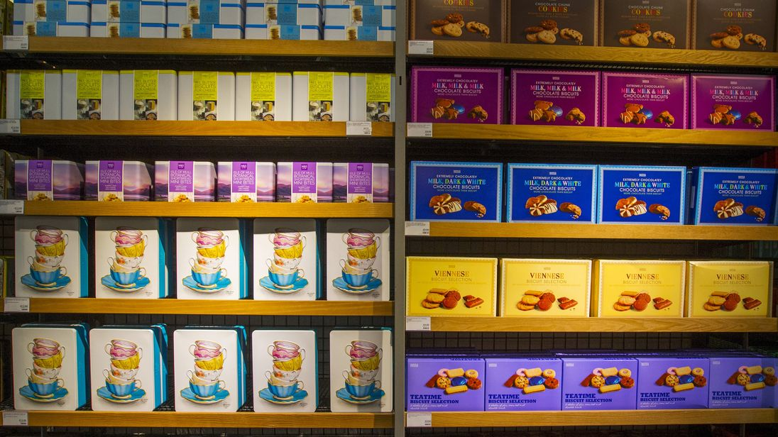 Boxes of biscuits are seen in the food department at a Marks & Spencer store